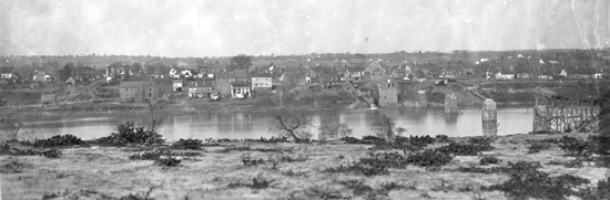 This view of Fredericksburg from Stafford Heights shows the ruined railroad bridge over the Rappahannock River