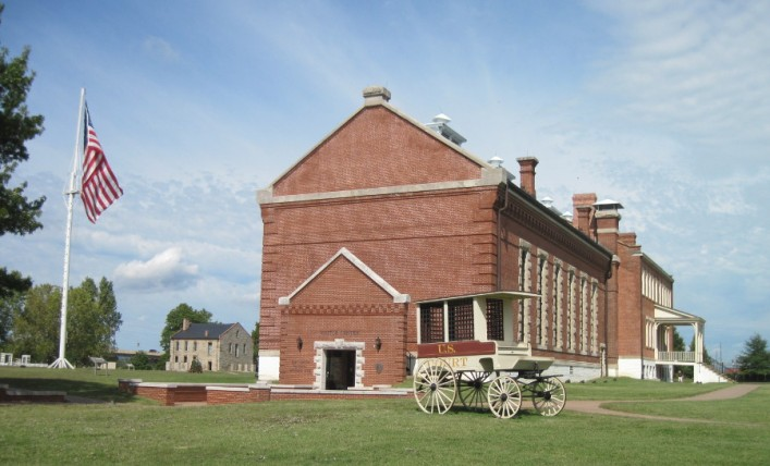 The main building has been expanded several times over the years. Today it is the Visitor Center and Museum. During its long career the building has served as a barracks, jail, commissary and courthouse. In the left background is an original commissary building from the Civil War period.